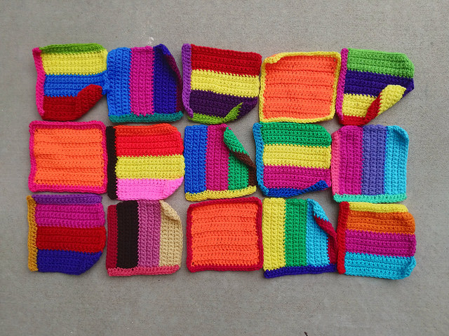 Fifteen six-inch crochet squares rehabbed from remnants