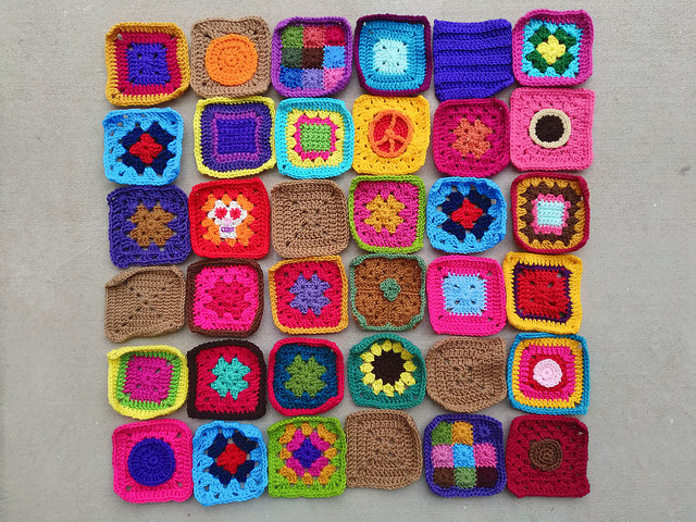 Thirty-six crochet squares rehabbed from remnants
