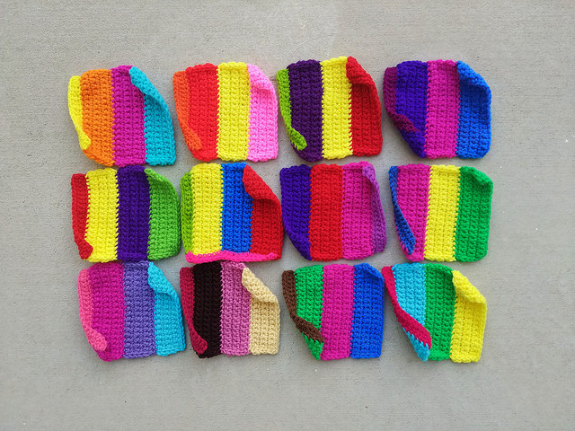 Twelve nearly completed television test pattern rehabbed crochet squares