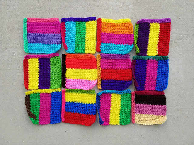 Twelve six-inch rehabbed crochet squares rocked and ready for adventure