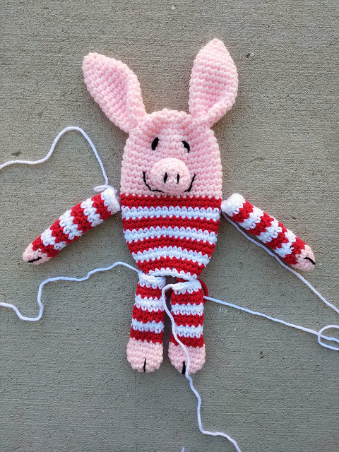 All of the pieces of a nearly completed Olivia inspired crochet pig