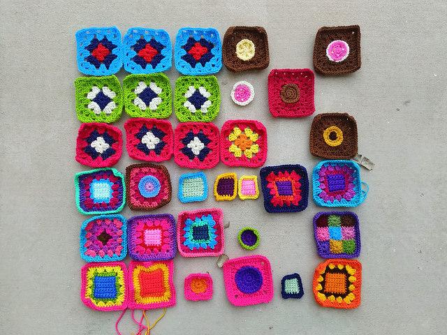 Thirty-three future five-inch rehabbed crochet squares