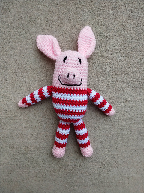 Olive the pig in striped pajamas