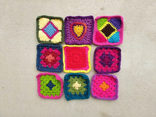 Nine newly rehabbed crochet squares that are part of the 187 crochet squares recently completed and ready for adventure