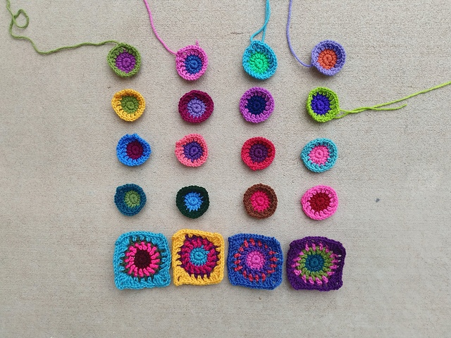 Crochet squares for a crochet purse in various stages of completion