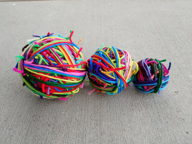Three magic balls of scrap yarn