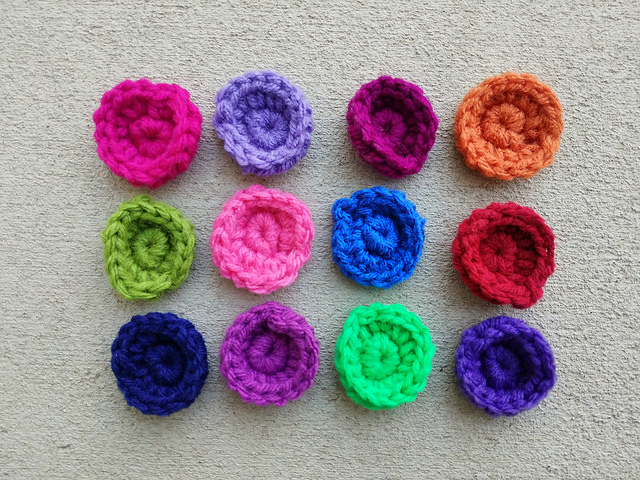 Twelve crochet circles for the center of twelve crochet squares