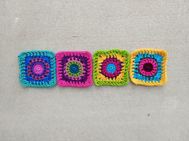 The four boho granny squares I decided not to frog rehabbed for Project Amigo
