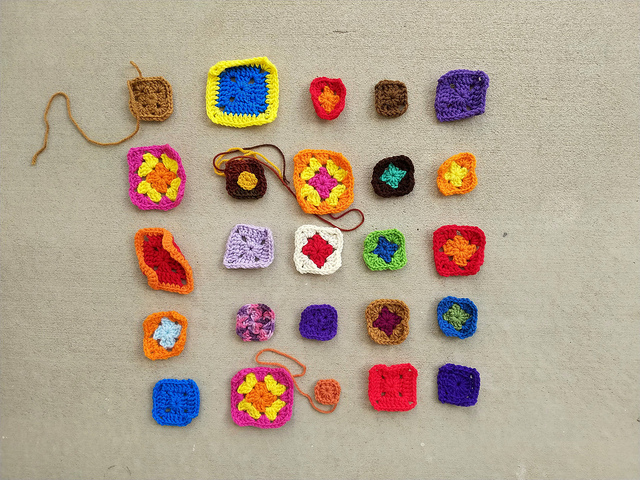 Twenty-five granny square crochet remnants