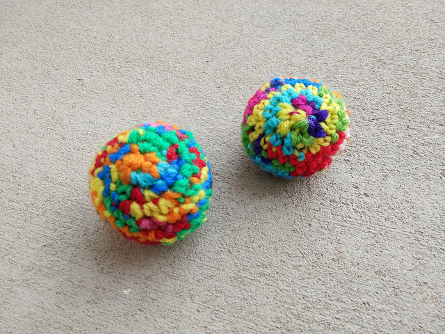 Two crochet scrap yarn ideal spheres for Marvin and Willie