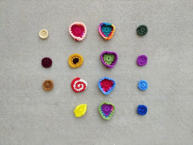 Fifteen of the sixteen original four-by-four of crochet remnants