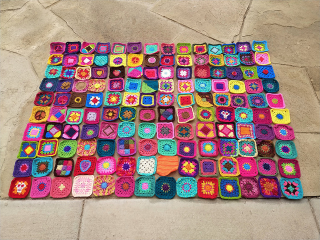 One hundred and forty rehabbed crochet squares ready for adventure