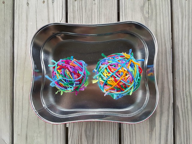 A tin of yarn scraps tidied up and ready for adventure