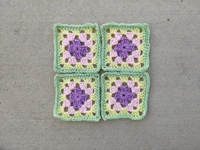Four formally too large granny squares rehabbed into six-inch granny squares