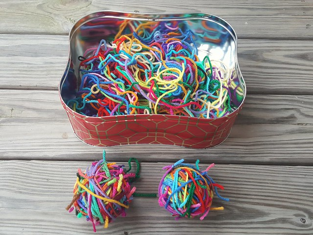 The same tin of yarn scraps after 30 minutes of tying yarn scraps end to end