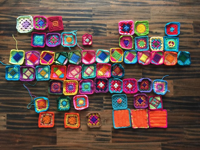 An overview of the fifty-five crochet remnants rehabbed and nearly ready for adventure