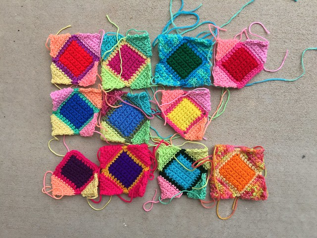 Eleven crochet remnants on the way to being five-inch squares