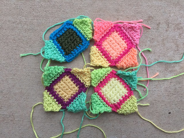 Four future five-inch crochet squares
