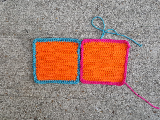Two bright orange lightly textured squares