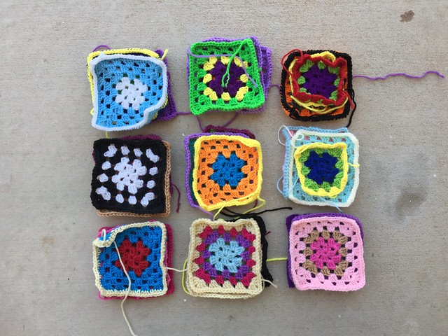 A nine patch of rehabbed crochet remnants three squares deep