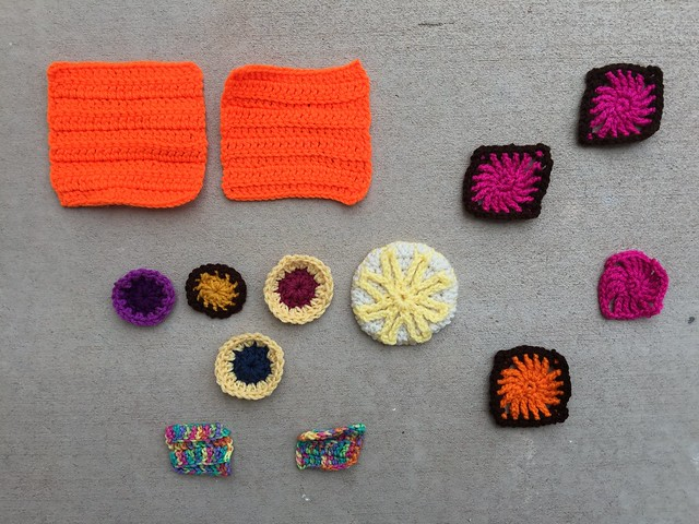 Thirteen crochet remnants ready for a round of rehab