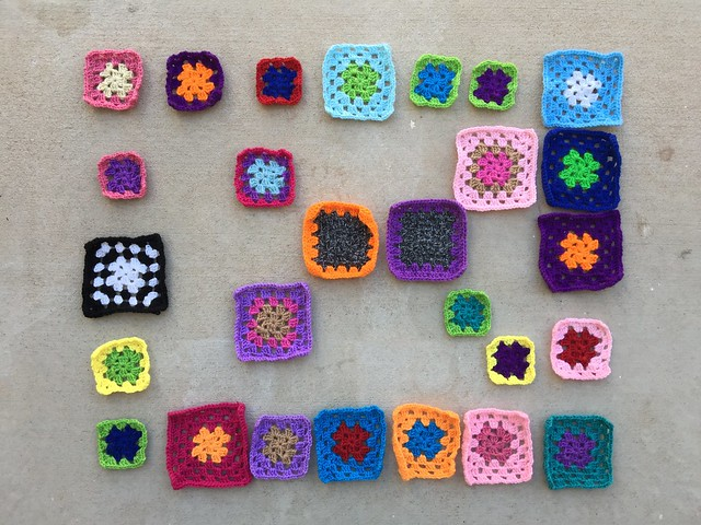 Twenty-seven crochet remnants ready for another round of rehab as the days grow shorter