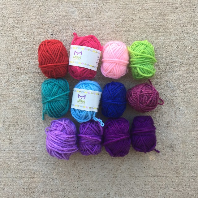 Working my way through a rainbow of mini skeins of yarn