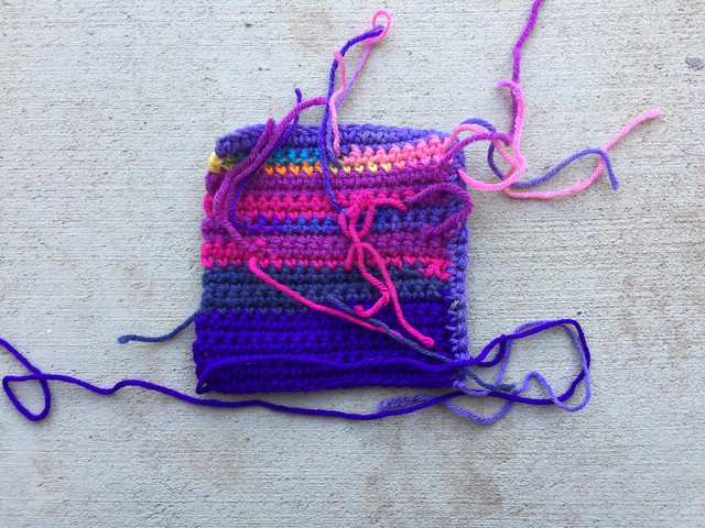 A purple square with ends to be woven in