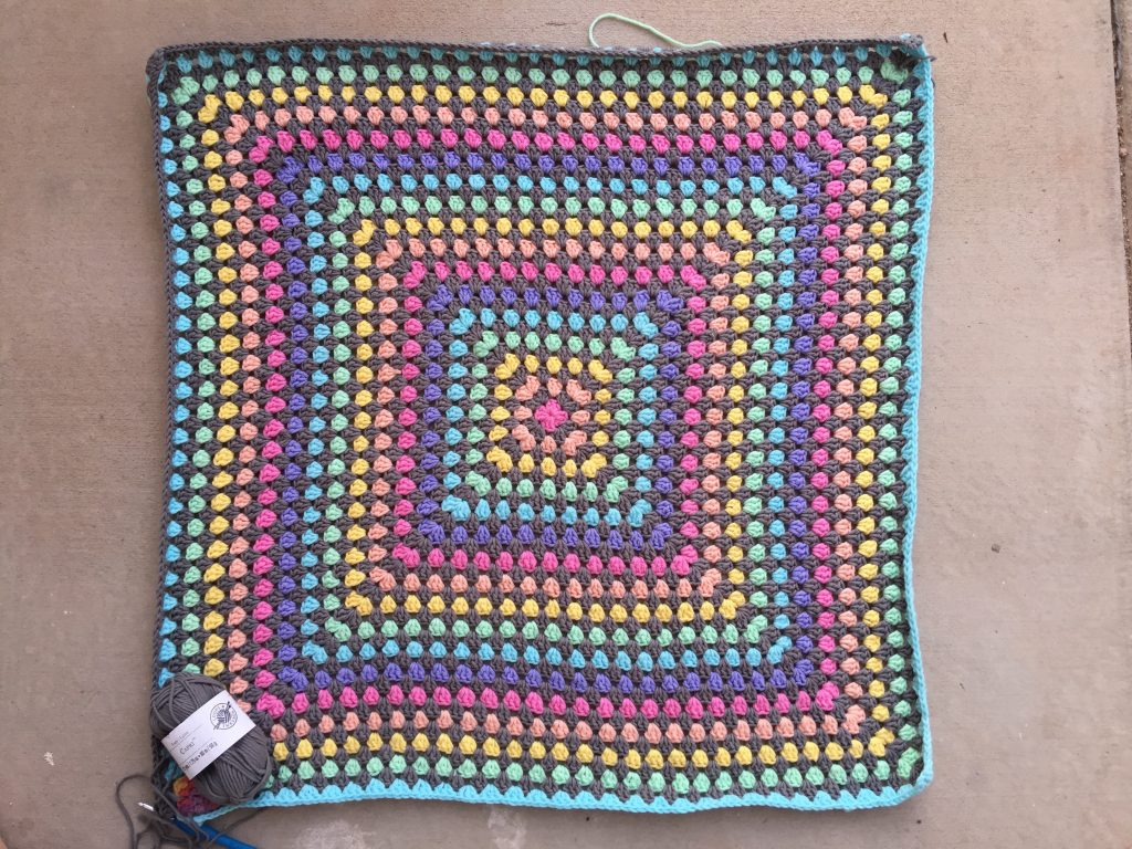 The great granny square blanket with just two-and-a-half rounds left to crochet
