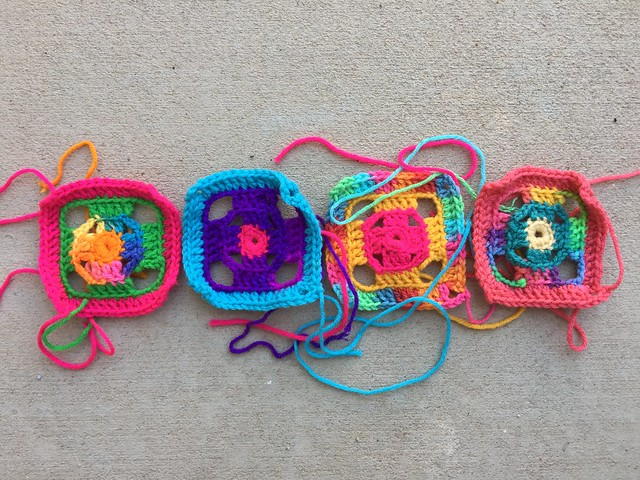 Four more four-inch flamboyant granny squares for a future crochet swag bag