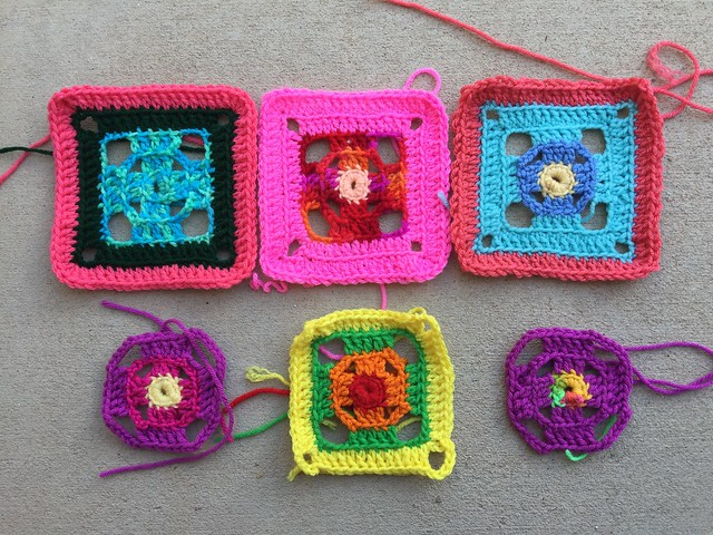 Six crochet granny squares in process for a Flamboyant Afghan
