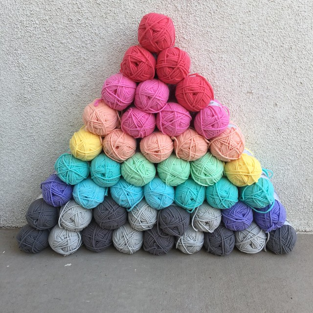 A pyramid of yarn that demonstrates the perils of a yarn sale