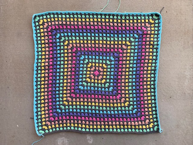 The first thirty-three rounds of a large crochet granny square blanket