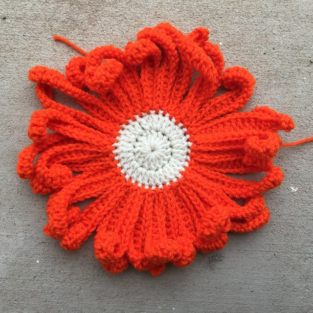 A very large crochet daisy
