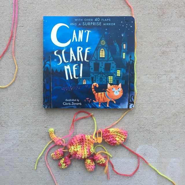 A Halloween book with all of the pieces f a hurry up crochet cat to go with it