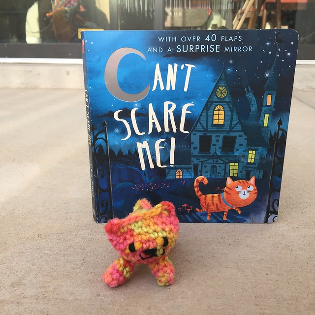 The book Can't Scare Me with a coordinating crochet cat