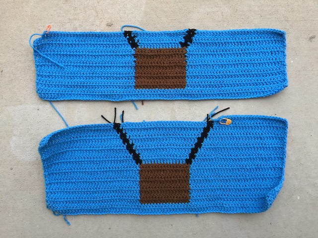 Two partially completed crochet panels for a hot air balloon inspired yarn bomb