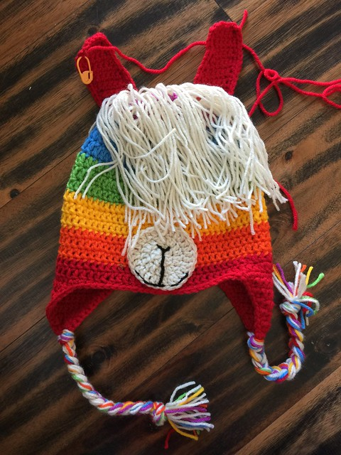 A rainbow inspired crochet llama hat for an adult made during a busy crochet hat season