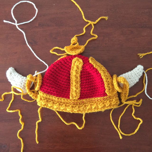 A crochet Viking helmet for a baby