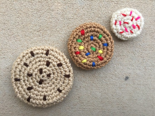 "Three crochet cookies that I made the day before my ""day trip"""