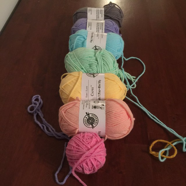 A rainbow of pastel yarns for a crochet hat