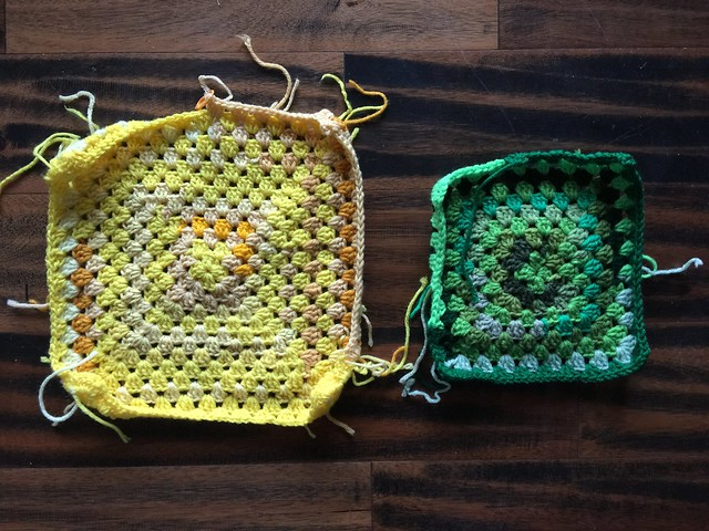 "The ""after"" of ""before and after"" using yarn scraps to crochet a yellow granny square and a green granny square."