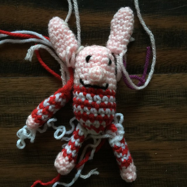 A mini-meta crochet pig inspired by Nabokov and Little Kiddles
