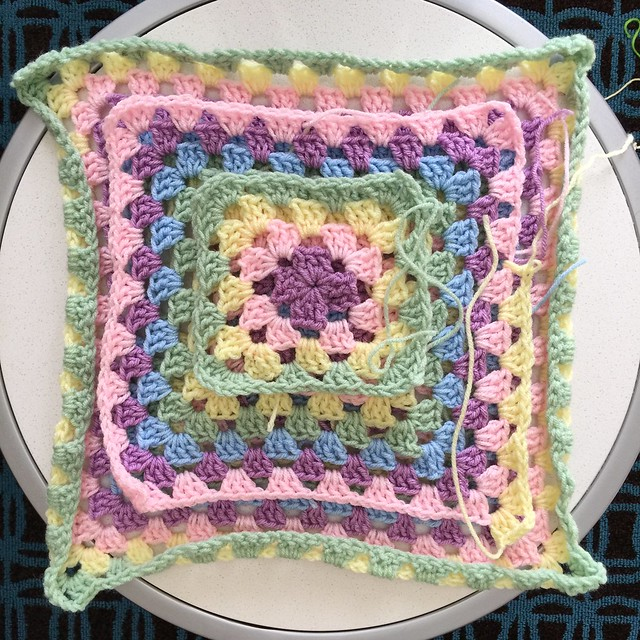 Three granny squares ready to be frogged for reuse.