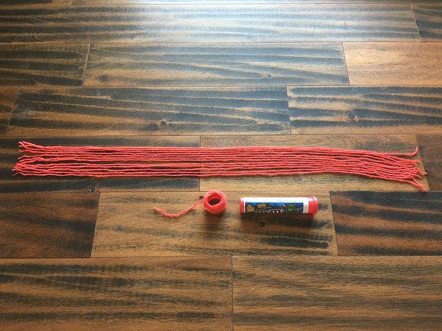 The same off-white yarn after kool-aid dyeing