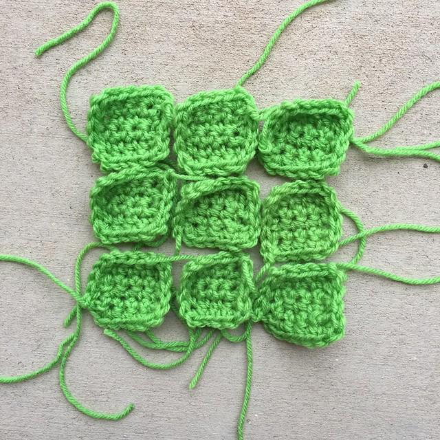 Nine bright green crochet squares