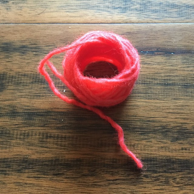A small skein of yarn after Kool-Aid dyeing