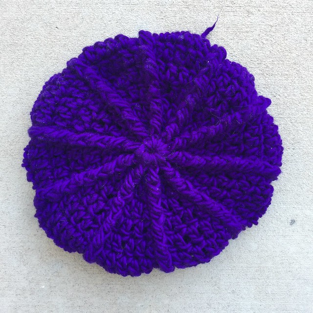 A view of the top of a newly crocheted textures newsboy hat