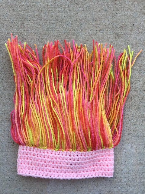 Variegated acrylic yarn for troll hair for a crochet troll hat, a project that is in the zone where angels fear to tread