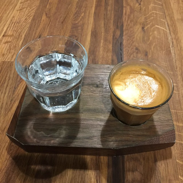 A celebratory macchiato with a seltzer water from Humble Coffee on the corner of 5th and Central in Albuquerque, New Mexico